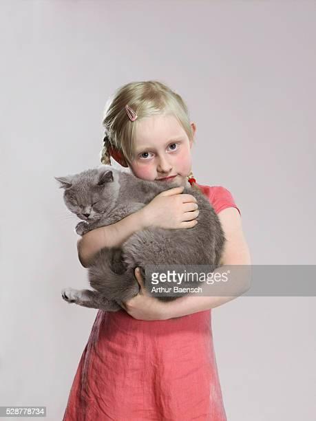 Girl holding large cat