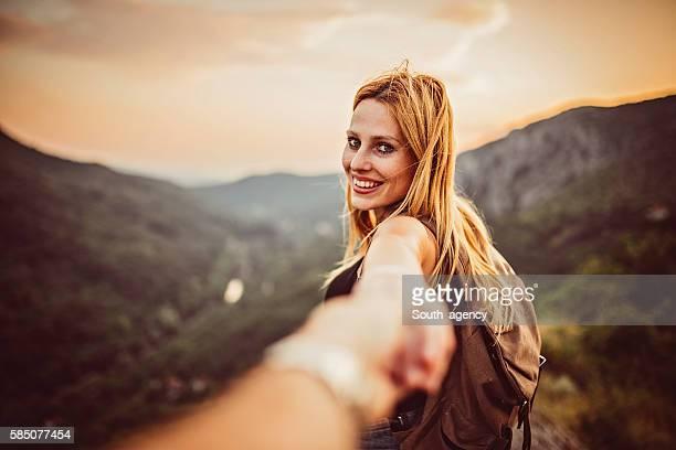 Girl holding man's hand