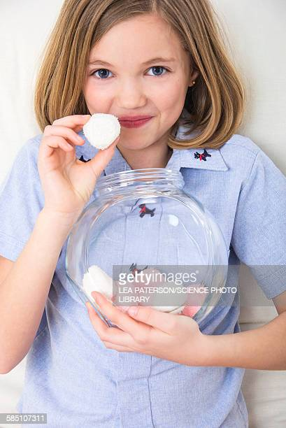 Girl holding marshmallows