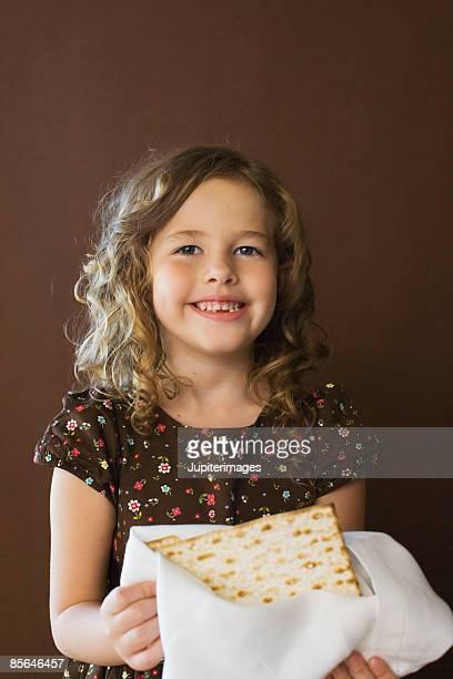 Girl holding matzoh