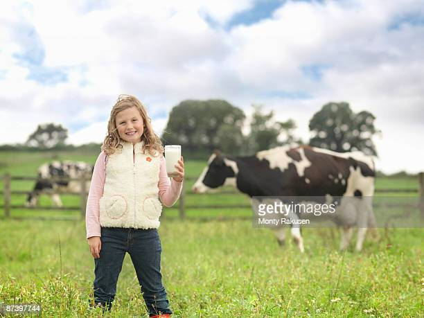 Girl Holding Milk With Cow