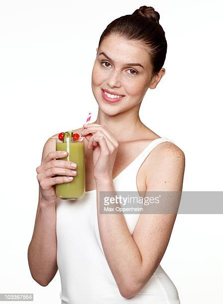 girl holding natural green drink