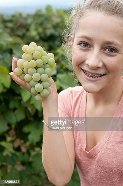 Girl holding Niagara grapes at an orchard