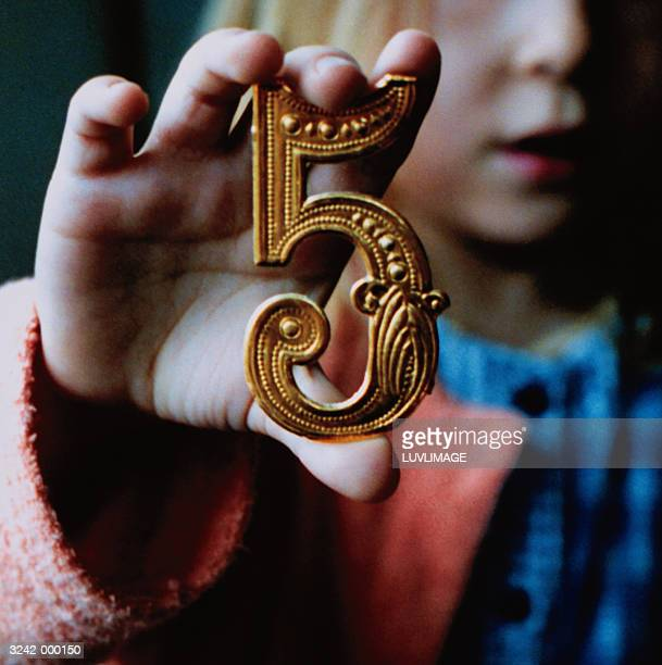 Girl Holding Number Five