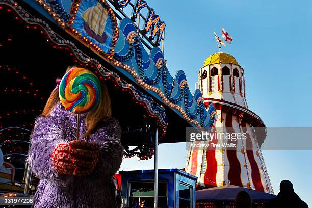 girl holding out a lollypop at the fairground - kingston upon hull stock pictures, royalty-free photos & images