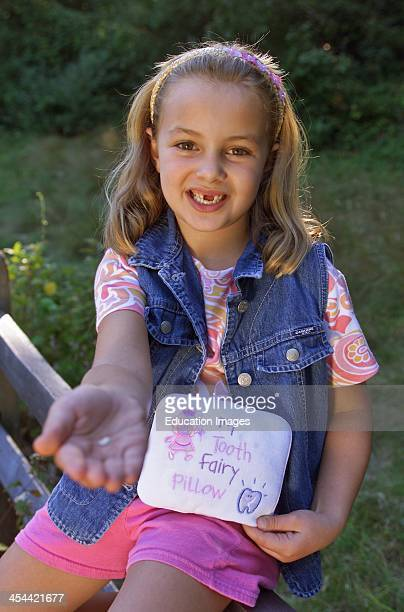 Girl Holding Out Handing Showing Missing Tooth