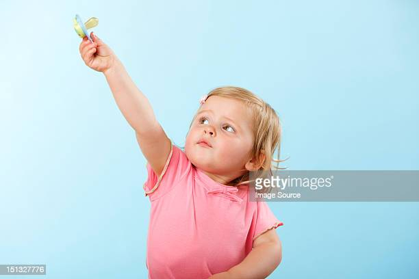 Girl holding pacifier