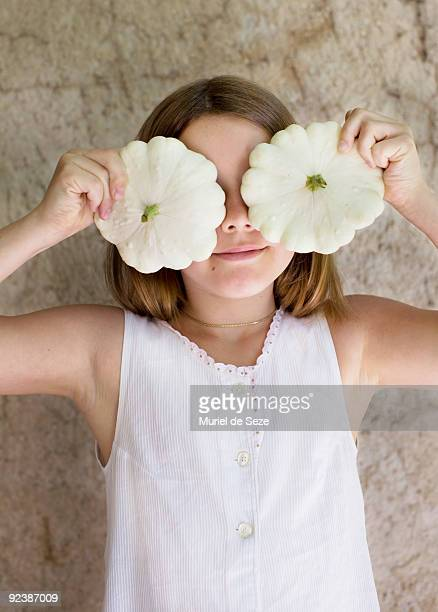 Girl holding patty pan squash