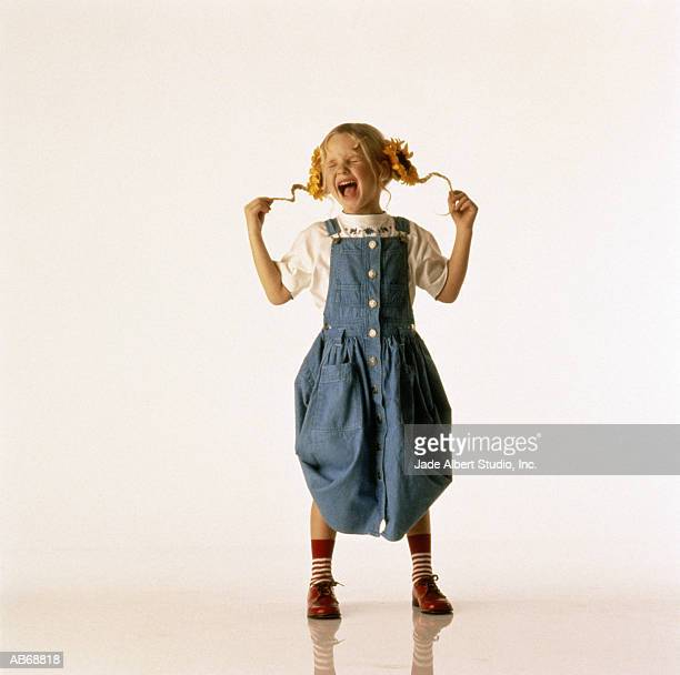 girl (3-5) holding pigtails, screaming - sadgirl stock pictures, royalty-free photos & images