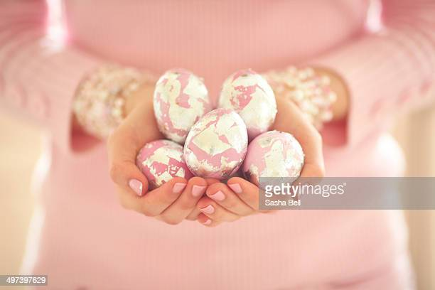 girl holding pink and silver easter eggs - sasha gray stock photos and pictures