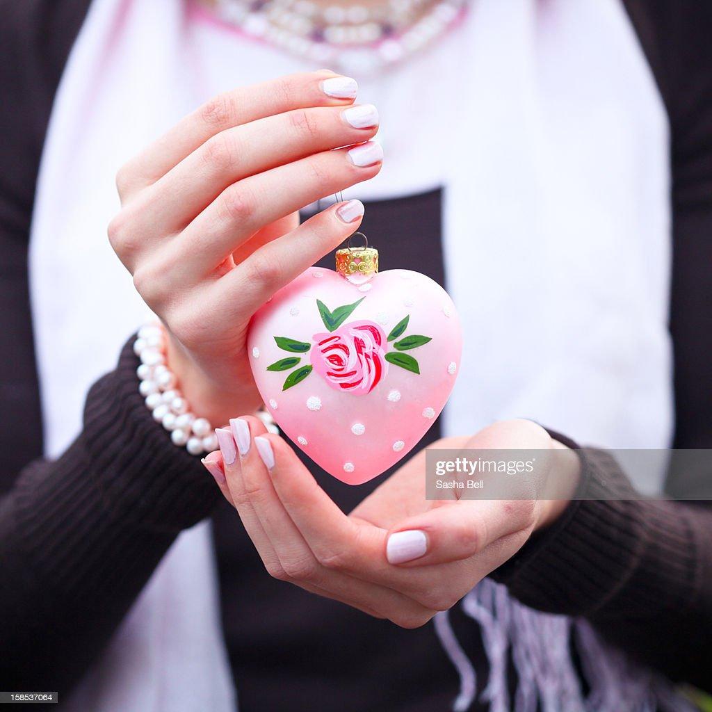 Girl Holding Pink Heart Christmas Decoration : Stockfoto