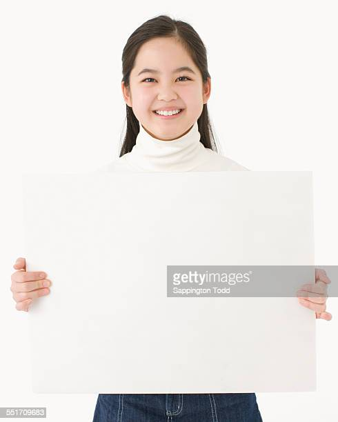 Girl Holding Placard