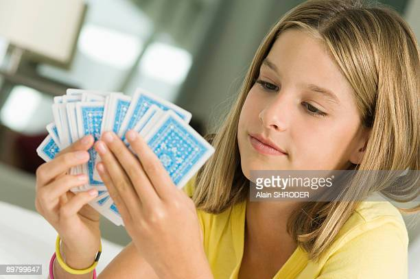 girl holding playing cards - thinking of you card stock pictures, royalty-free photos & images