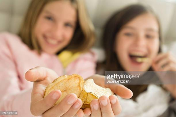 Girl holding potato chips in her hands