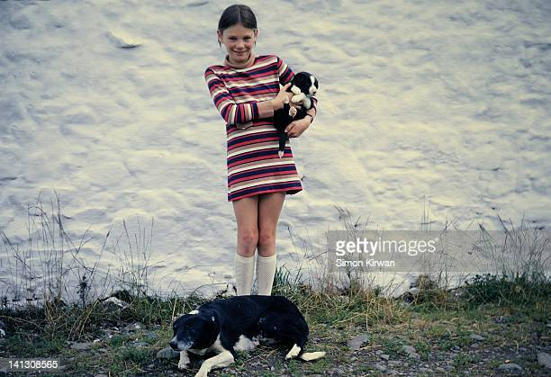 girl holding puppy with dog at farm - 1970 stock pictures, royalty-free photos & images