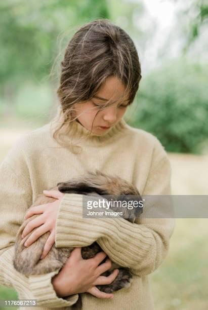 girl holding rabbit - 齧歯類 ストックフォトと画像