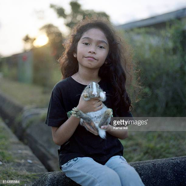 girl holding rabbit - malaysia beautiful girl stock photos and pictures