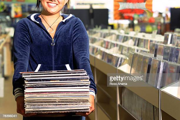 Girl holding records
