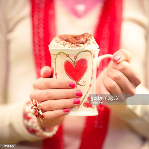Girl holding red heart mug