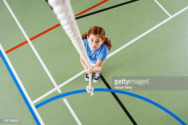 Girl holding rope in gymnasium