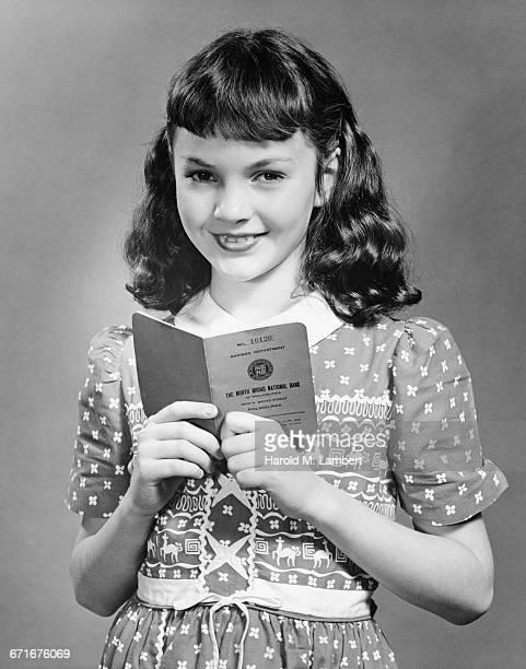girl holding savings book - escrita ocidental - fotografias e filmes do acervo
