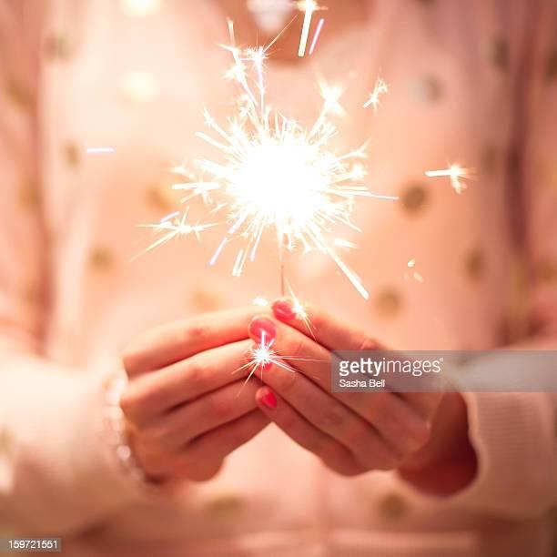 Girl Holding Small Sparkler