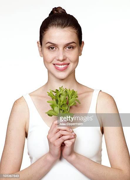 girl holding stalks of fresh mint
