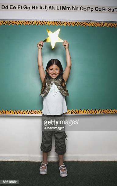 Girl holding star