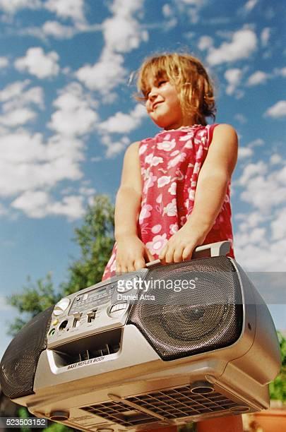 Girl Holding Stereo