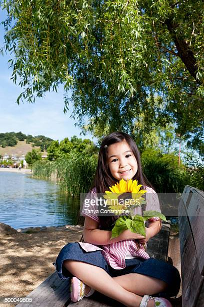 Girl holding sunflower