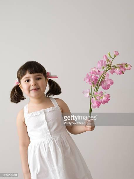 Girl holding sweetpea flowers