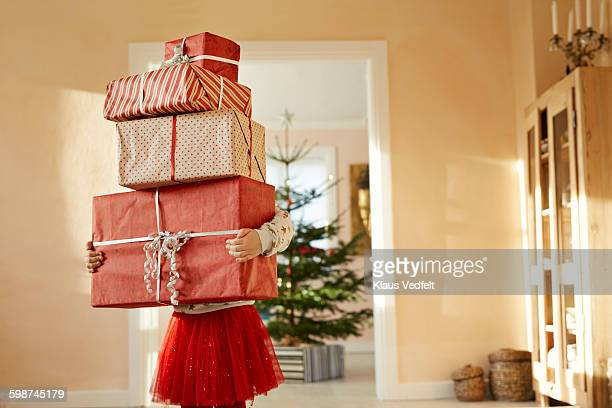 girl holding tall stack of christmas presents - gift stock pictures, royalty-free photos & images