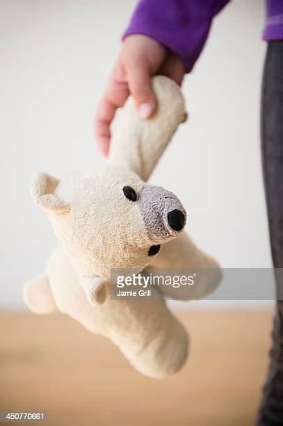 Girl (8-9) holding teddy bear