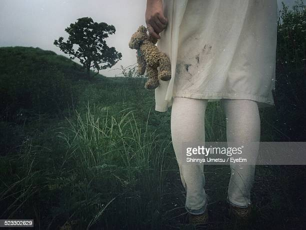 girl holding teddy bear - child abuse stock pictures, royalty-free photos & images