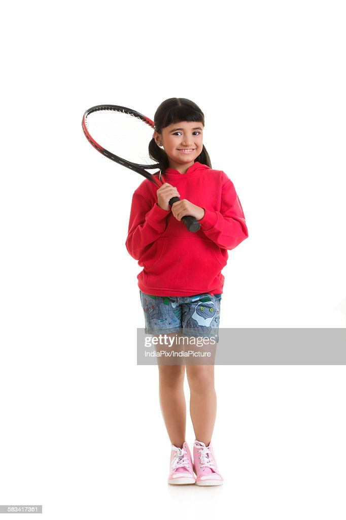 Girl holding tennis racquet : Stock Photo