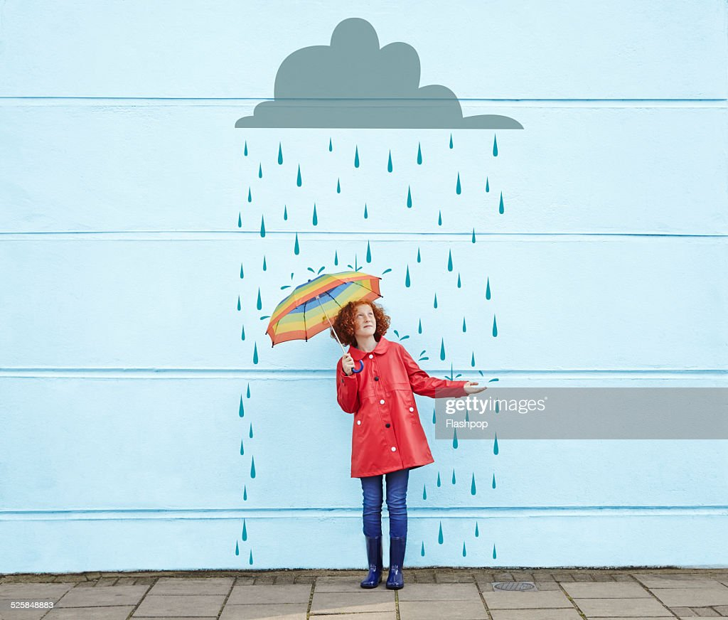Girl holding umbrella with cartoon rain cloud : Stock Photo