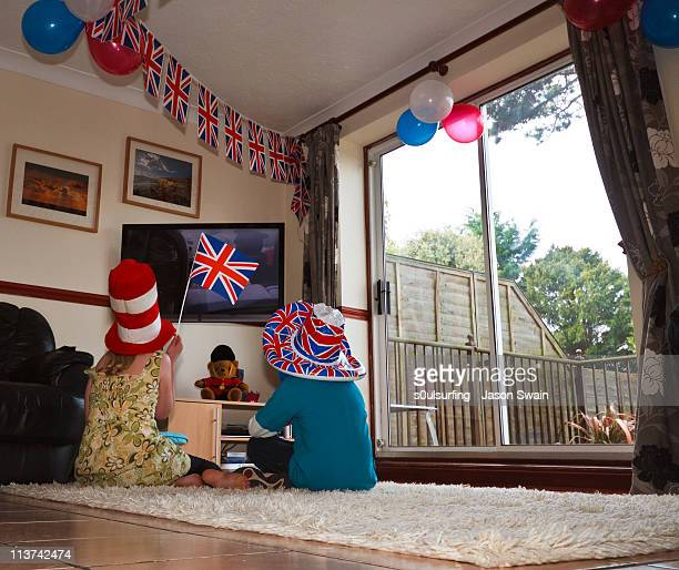 girl holding union jack flag - s0ulsurfing stock pictures, royalty-free photos & images