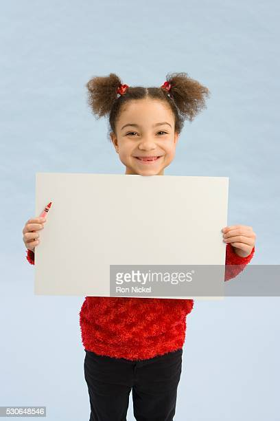 Girl holding up a book