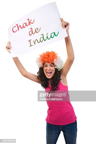 Girl holding up a placard and cheering