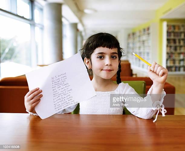girl holding up finished poem