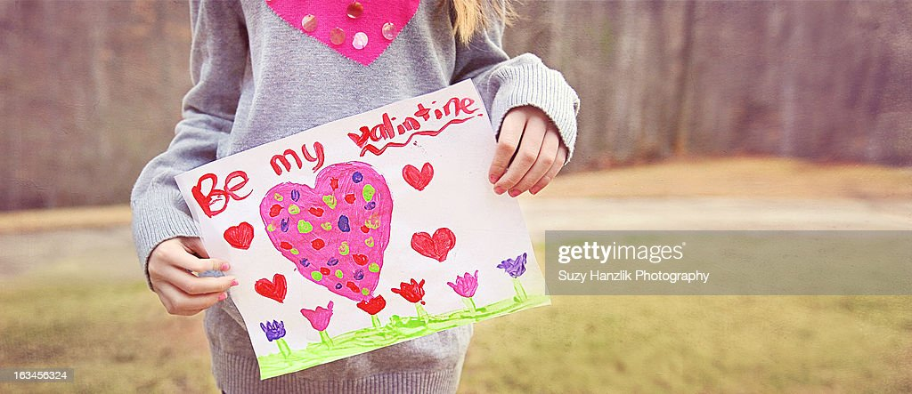 girl holding Valentines Card with pink heart : Stock Photo