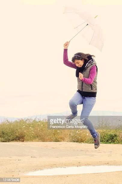 girl holding white umbrella - tempio pausania stock pictures, royalty-free photos & images