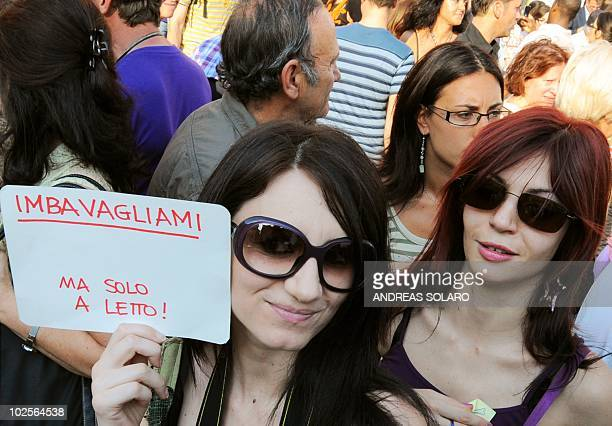 """Girl holds a banner reading """"put a gag on me but only in the bedroom """" during a rally against the so called legge bavaglio """"gag law"""" in Rome on July..."""