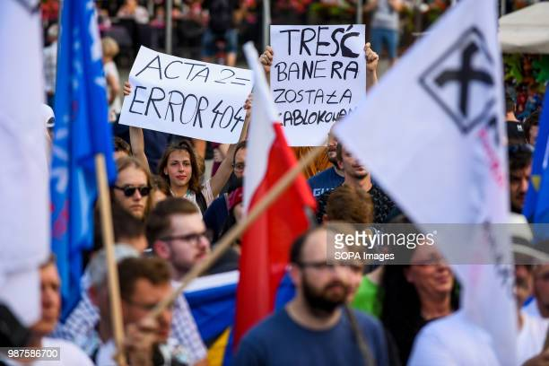 A girl holds a banner saying 'ACTA2= ERROR 404' during a protest against the implementation of ACTA 2 in European Union On June 20th The Legal...
