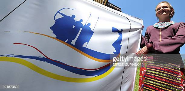 A girl holds a banner with Kiev's logo for the EURO 2012 during a presentation ceremony in central Kiev on June 8 2010 Kiev is the second of the...