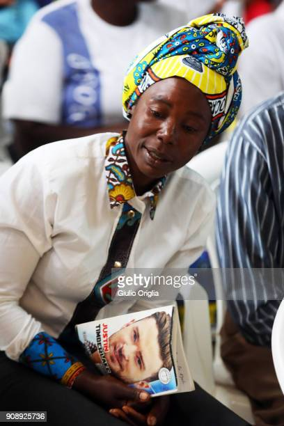 A girl holds a book of Justin Timberlake as she attends the Sunday mass at the Salesian church of Kalulu on January 21 2018 in Luanda Angola Angola...