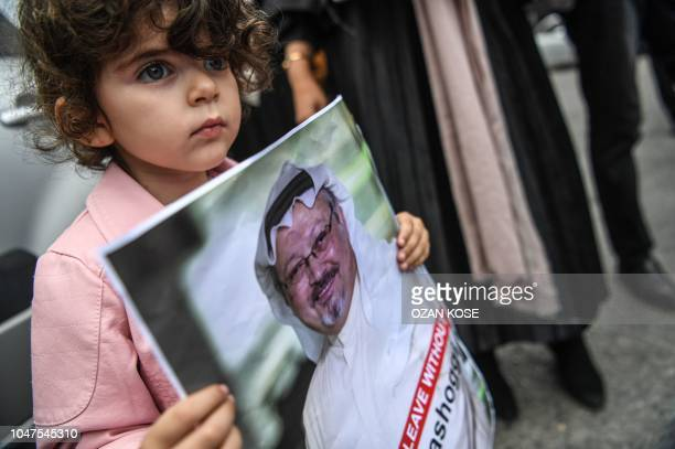 A girl holds a picture of missing journalist Jamal Khashoggi during a demonstration in front of the Saudi Arabian consulate on October 8 2018 in...