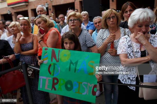 A girl holds a placar reading 'No more terrorism' during a vigil in tribute to Ignacio Echavarria a victim of the London terror attack outside of Las...