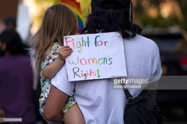 Girl holds a placard as protesters take part in the Women's March and Rally for Abortion Justice in New York, on October 2, 2021. - The abortion...