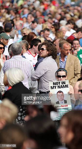 A girl holds a placard of murdered Police Constable Ronan Kerr amoung thousands of people as they attend a walk through the County Tyrone town of...